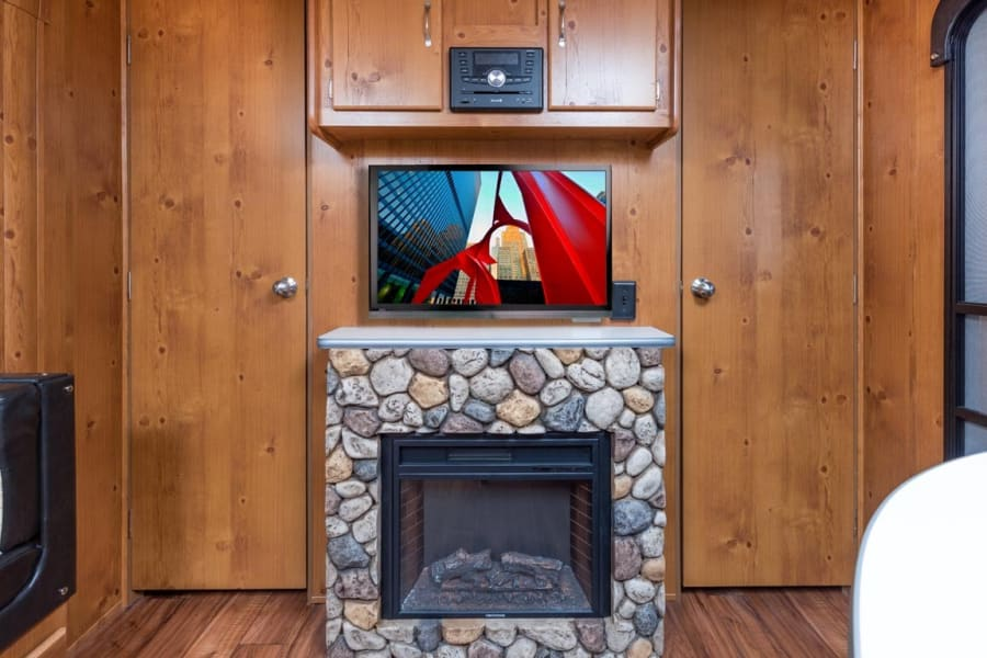 Entertainment area with fireplace, Bluetooth connection, Radio, DVD player. Local cable hook up.