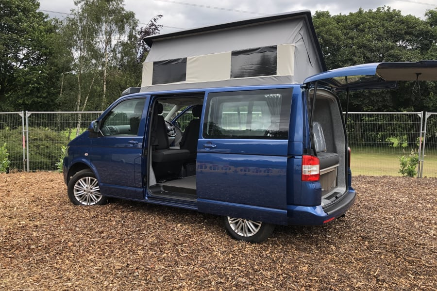 Harvey side view with elevating roof & rear hatch.