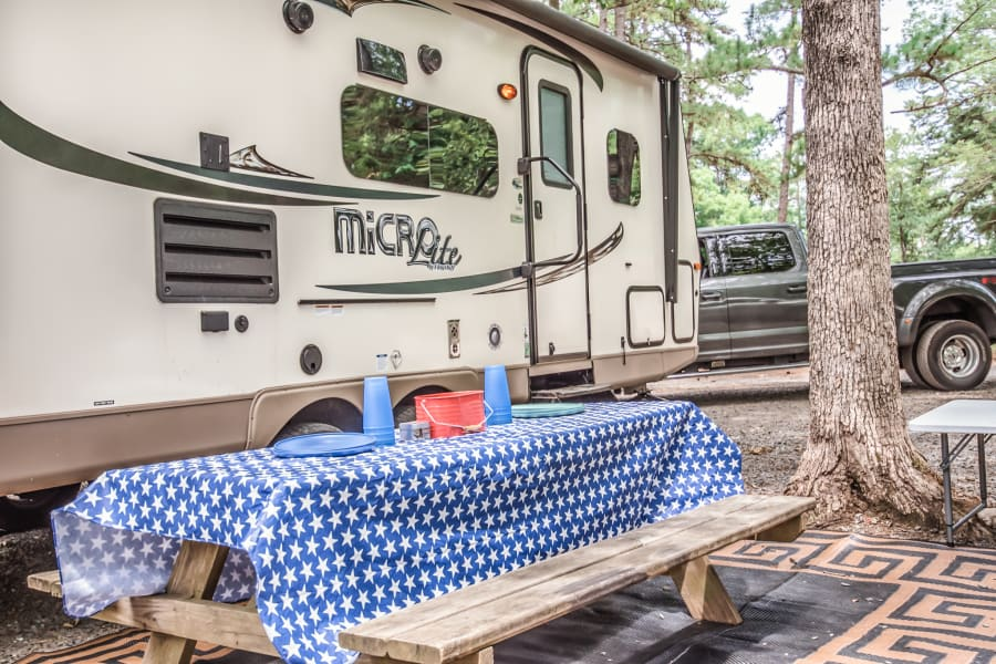 Camper comes with a beautiful picnic tablecloth, outdoor utensils, and have you a wonderful grilling time!