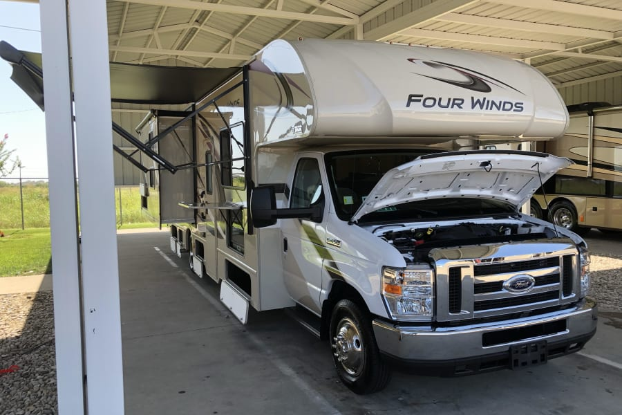 Passengers slide out with awning and lots of storage compartments.