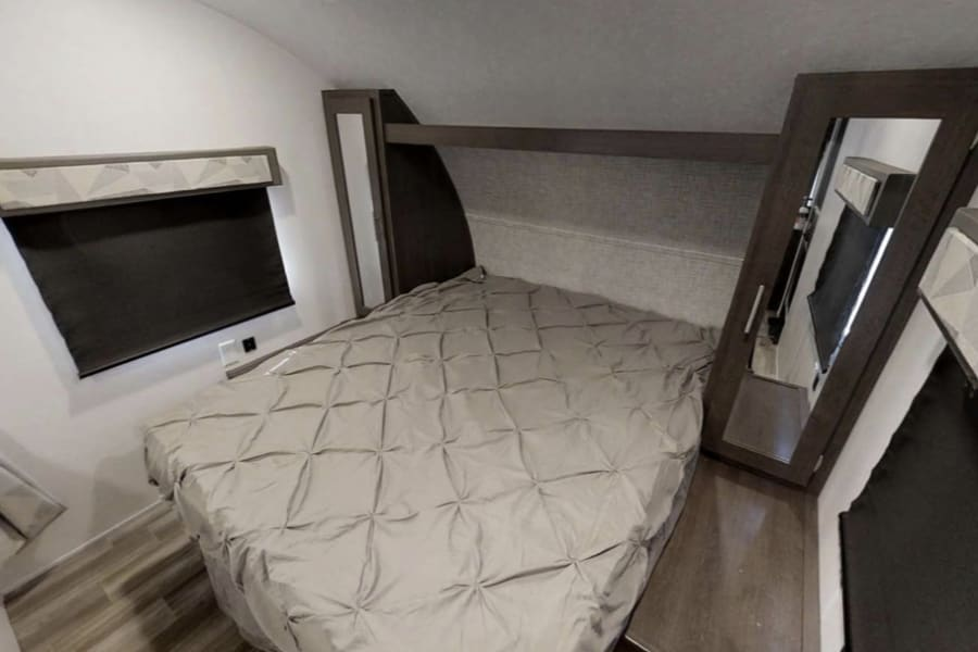 Queen bedroom with blackout shades & plenty of storage in closets and under bed.