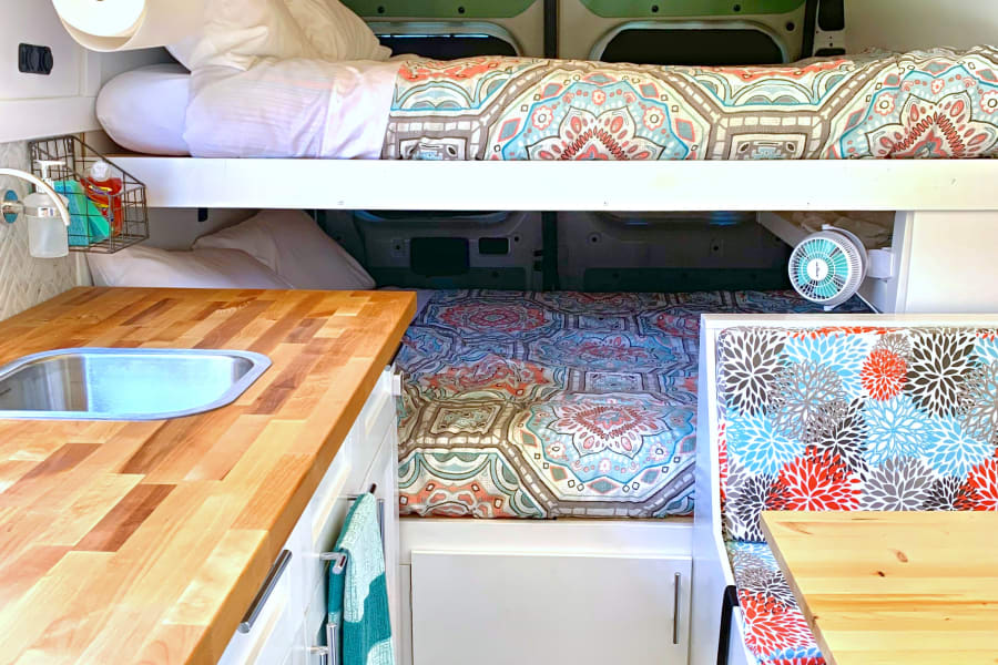 Bunks, updated kitchen and seating for all!