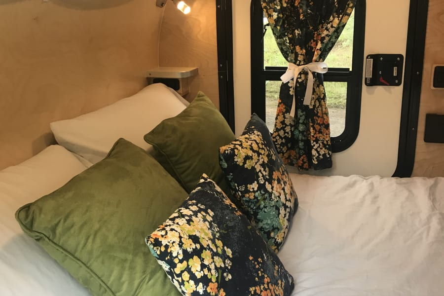 Margot's interior is cozy and colorful and features a comfy mattress and windows / doors on BOTH sides of the bed.  Need linens?  Ask for our bedding upgrade.