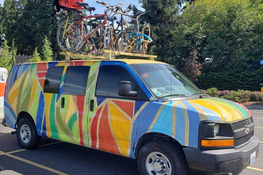 Exterior of the van plus example of 5 bikes on top rack.