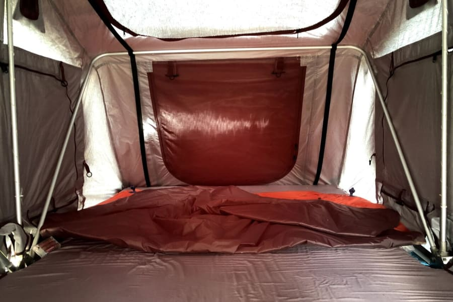 Inside rooftop camper when deployed. sleeps 2-3 comfortably