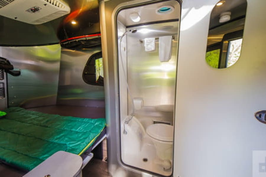 Airstream Basecamp for rent. The full bathroom with shower, toilet and extra storage makes for a comfortable and clean weekend.