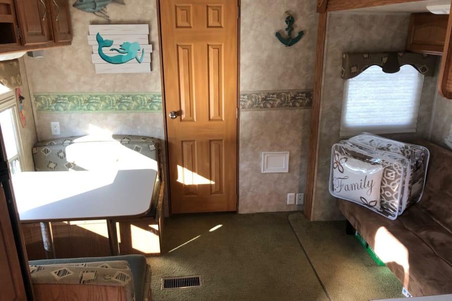 dining/sleep area with sofa/sleeper