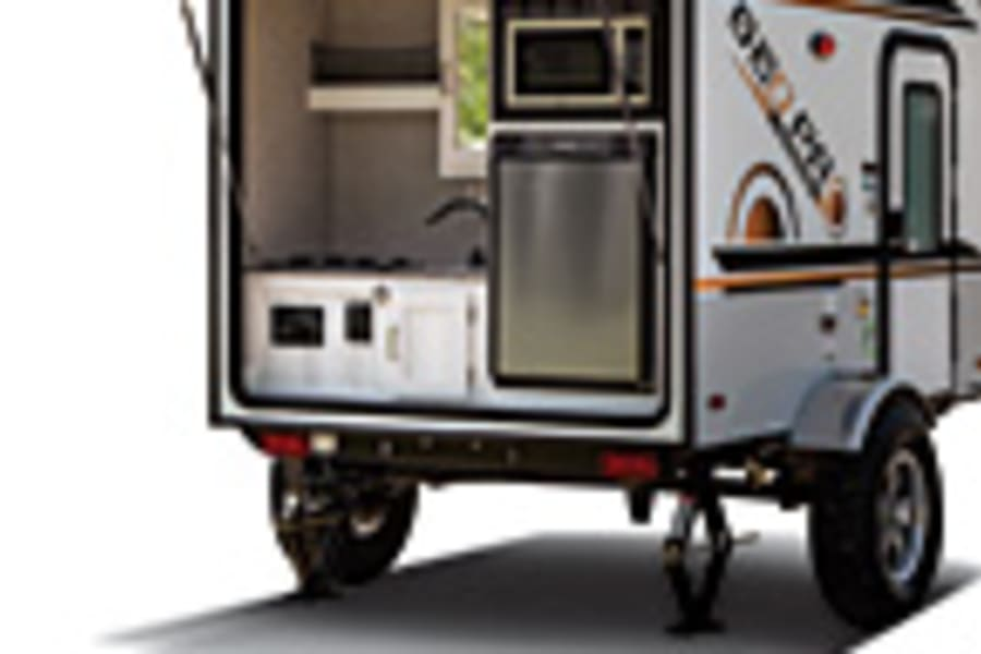 Picture of the exterior. yThe exterior shower has a curtain that wraps around the rear door and the kitchen sink has a shower attachment.
