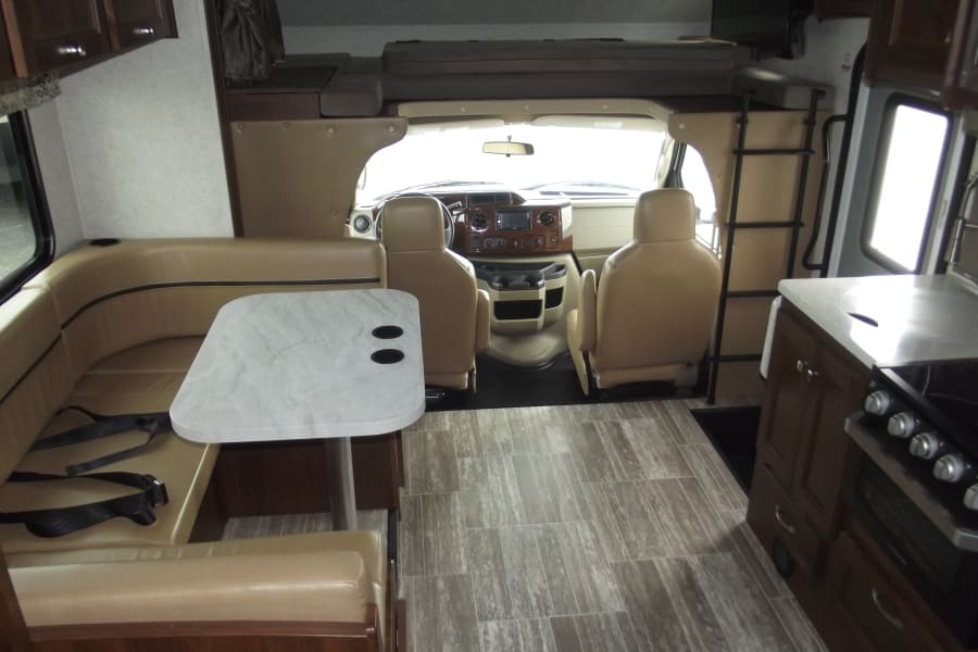 Dining table, over-cab sleeping area, TV (w/DVD player), etc.
