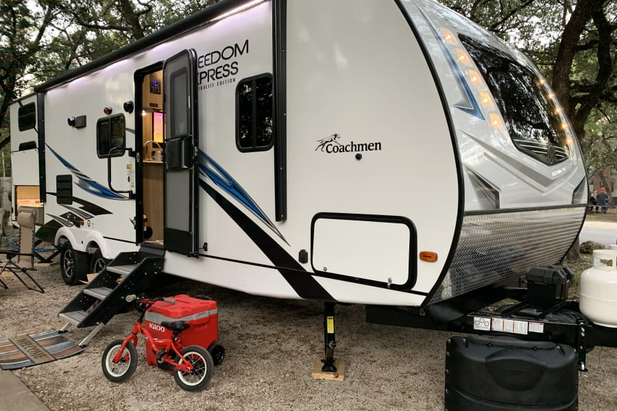Built in exterior lighting under the awning and in front of the trailer add plenty of light at night