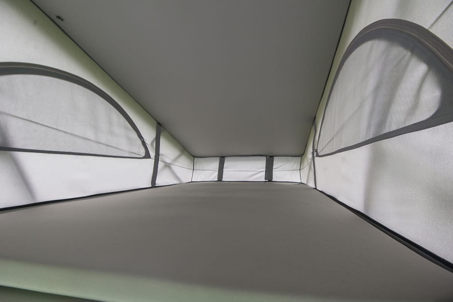 The 'secret' bed in the pop up roof has plenty of room for 2 adults
