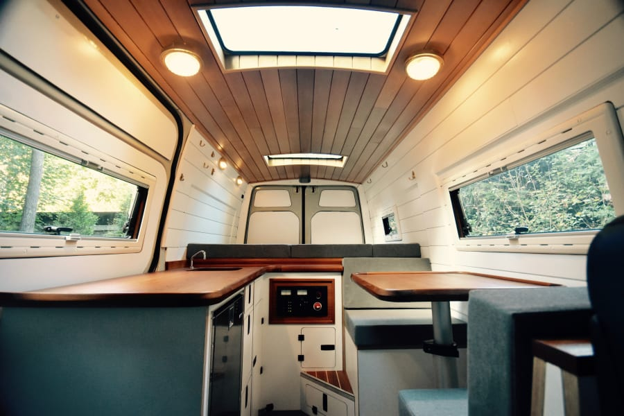Skylight above galley teak counter and teak dinette table