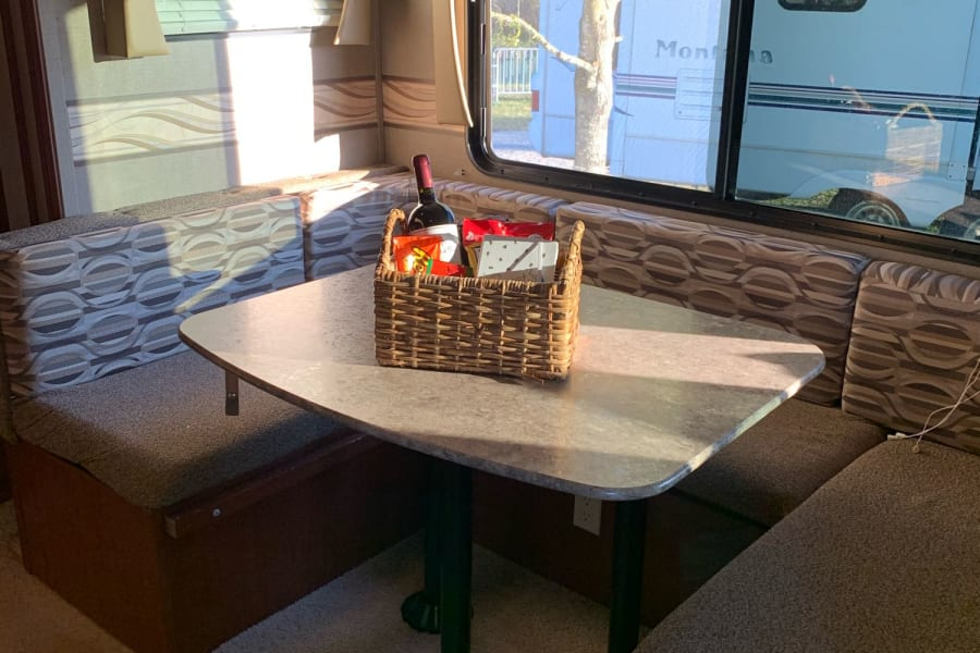 For each person, group or family who rents from us we try to customize a Welcome basket and leave some special goodies, Wine for Mom and snacks for everyone else sometimes a Smore's Kit my favorite.  This dinette seats 7 comfortably and makes into a full size bed for 2 adults.