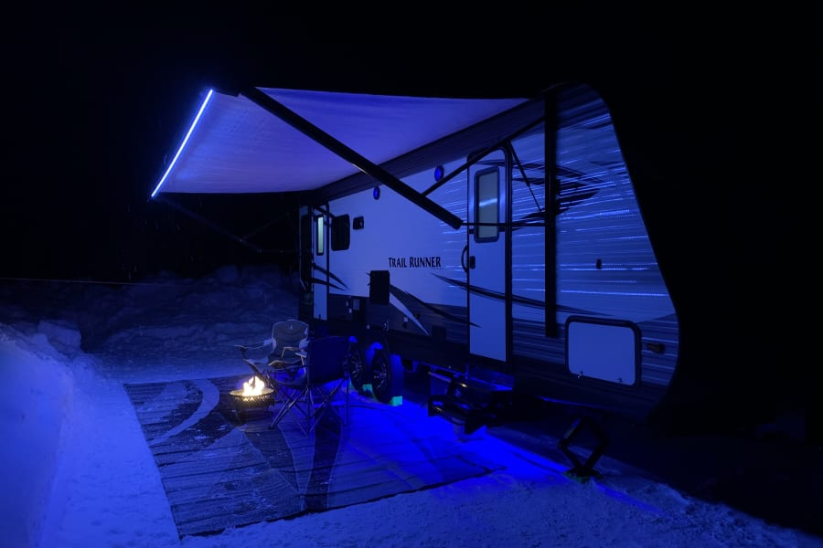 Features white LED lights along the awning and blue LED lights along the bottom of the trailer.