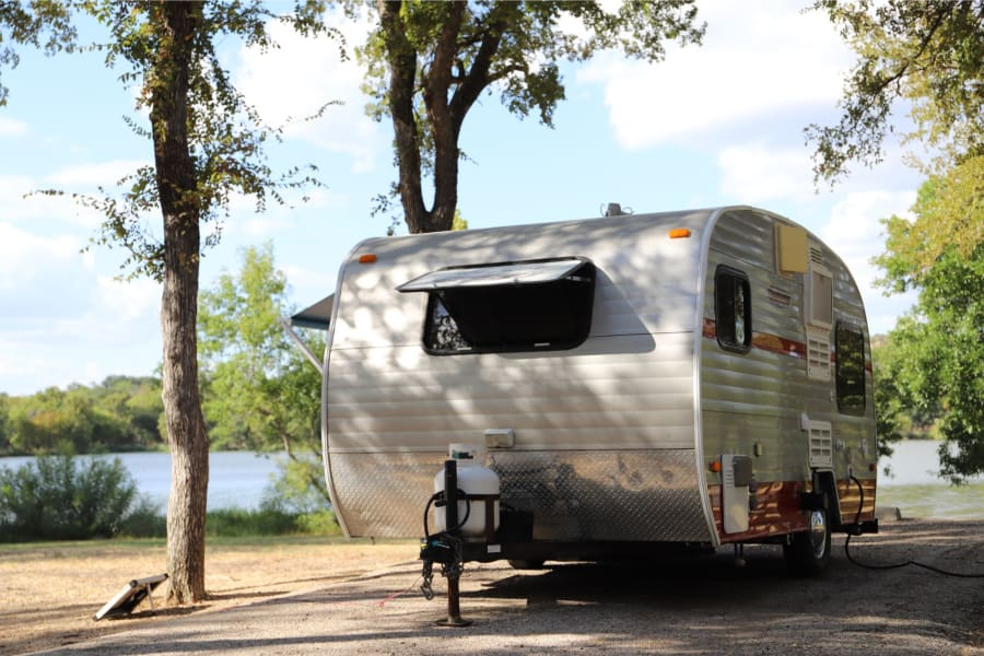 Quick set-up: unplug the electric cord from your car, Remove hitch from the car—or not. Plug in camper 30 volt at campsite. camper has built-in adjustable leveling feet in back, one on each side, which can be used if needed.
