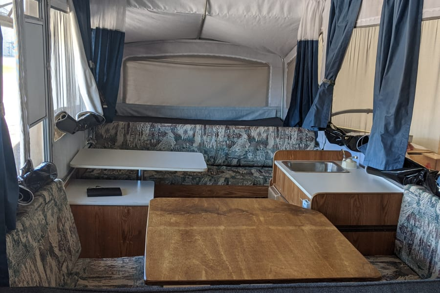 Looking aft. The double bed is behind the sofa. There are two AC outlets if you want to bring a TV or other appliance.
