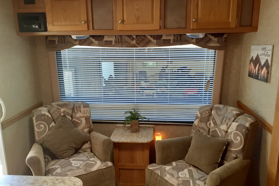 Comfortable swivel rocking chairs and large picture window provide a great place for.morning coffee. Fully stocked coffee bar provided!