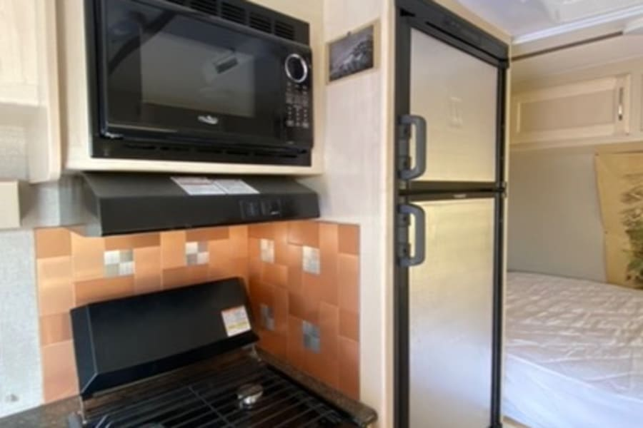 3 burner stover and oven and microwave and bigger fridge with separate freezer