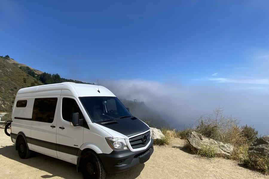 Watching the fog roll in over the cliffs in Big Sur