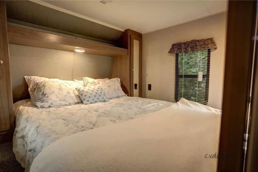 Comfortable and cozy queen bed. Rest well after a day of camping fun.