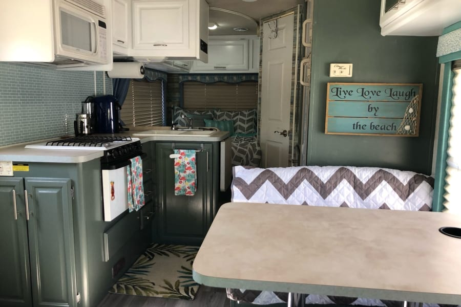 Full kitchen and dinette that converts to full size bed.