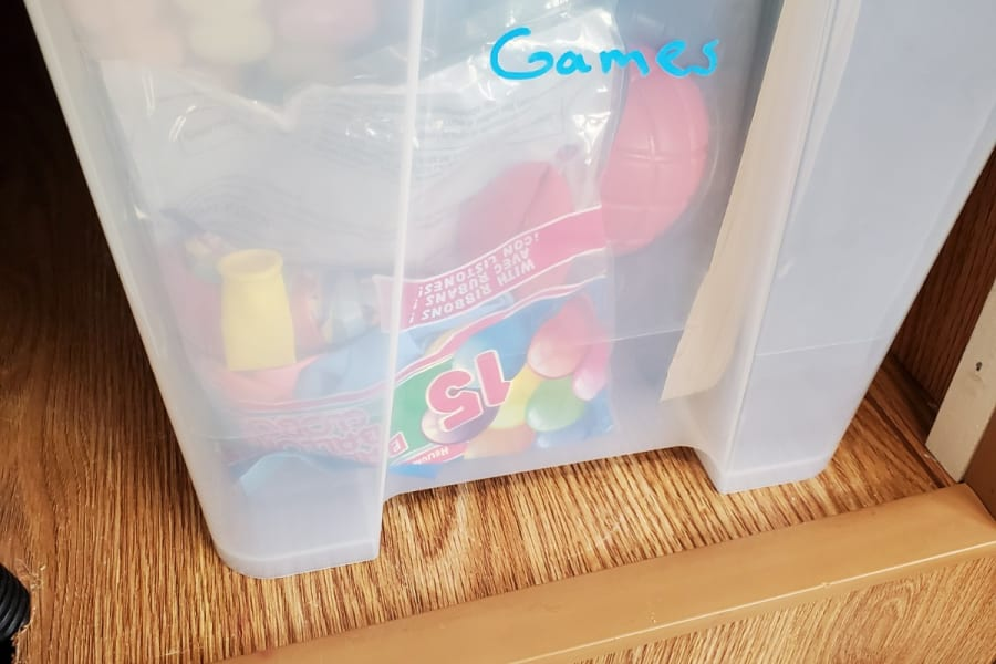 bin of toys and games and word search books