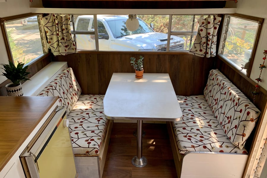 Dinette converts to short bed and seats 4.