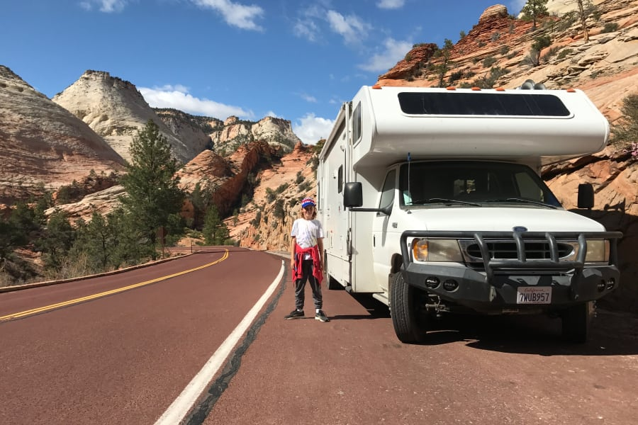 Traveling through Utah in the RV. Parking on the side of the highway and setting off for a day hike with my son in Zion National Park.