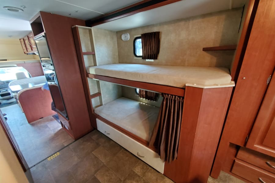Bunk beds that the kids love! Its like their own fort.