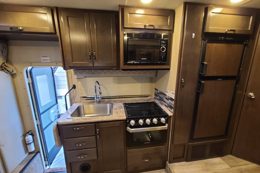 Kitchen area, with propane stove top, oven and Convection microwave