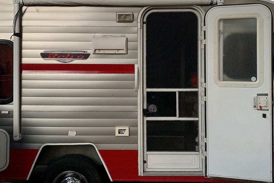 Screened front door: Walk in to a cozy retro camper with today's luxury features—amazingly comfortable living space—all in a small 13 x 6 1/2 foot space!