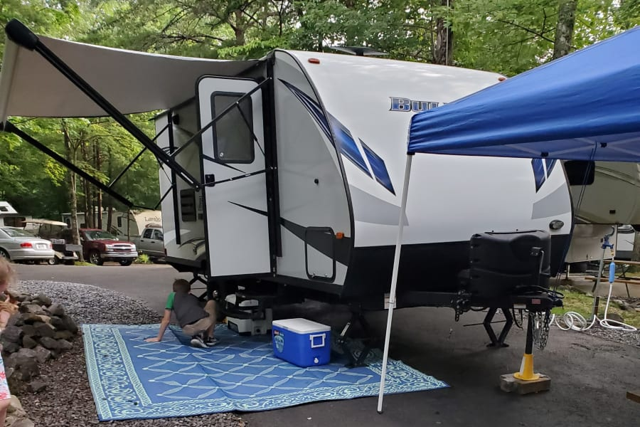 Camper setup with awning extended.