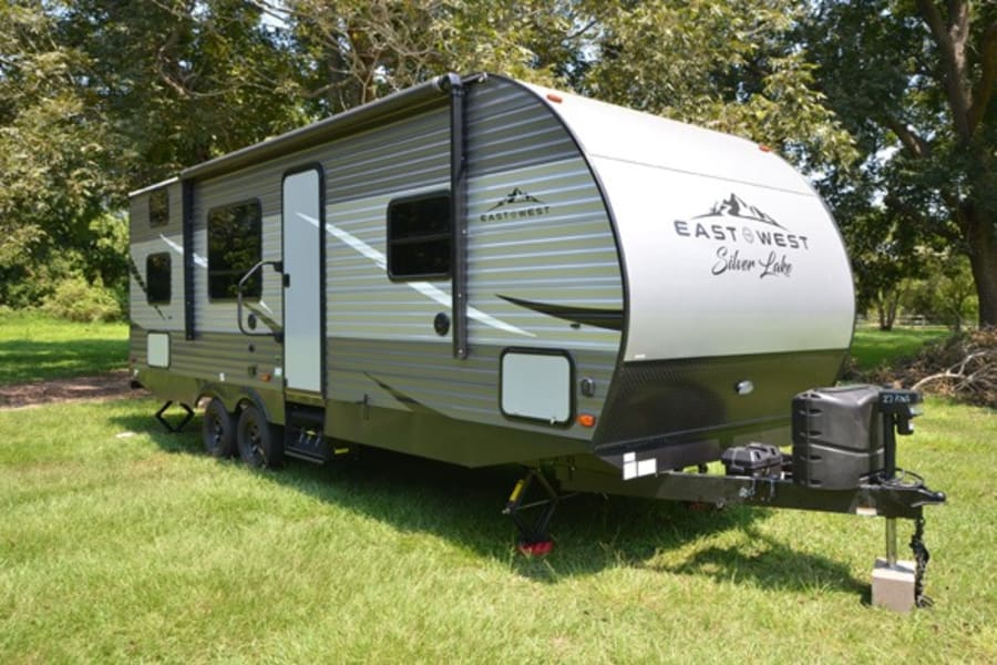 This brand new camper is ready for you!