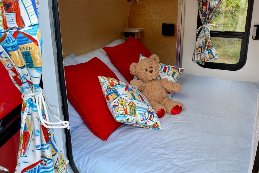 The queen bed is NEW and firm and the cabin includes curtains for privacy.