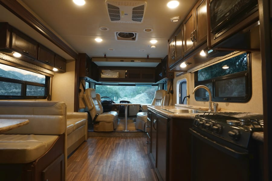 Open floor plan. Driver and Passenger chairs swivel to allow for extra seating. Table is removable while driving.
