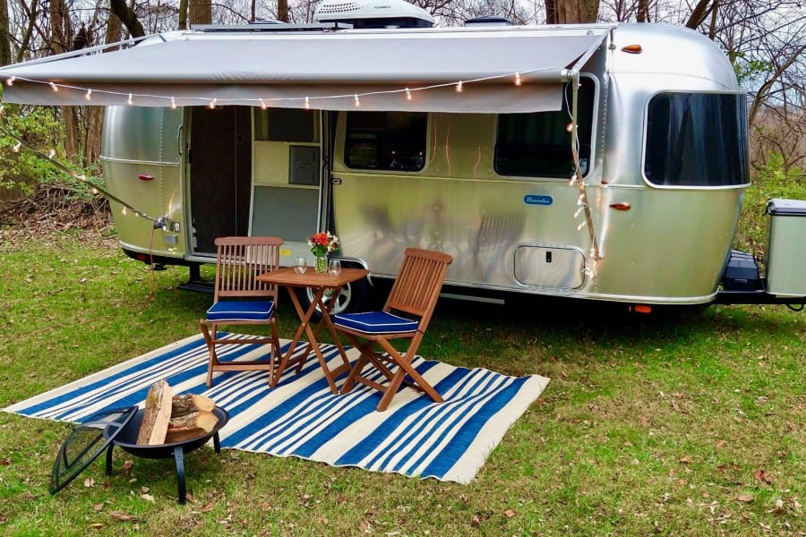 Beautiful exterior setup (table, chairs, carpet, portable fire pit are available as Add Ons)