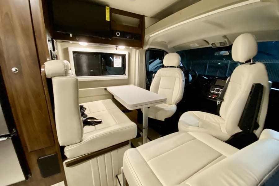One of our favorite spots!  The driver and passenger seat swivel and voila! you have a nice eating area, a work area  and even great area for cards.