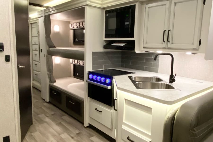 Kitchen space and peek into bunk beds