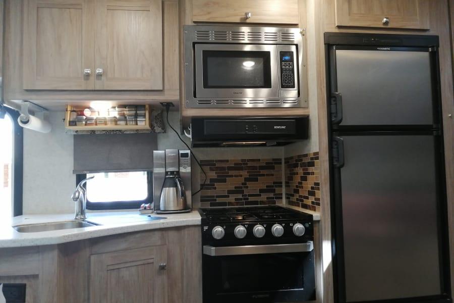 3 burner propane stove and propane oven. Lots of kitchen storage.
