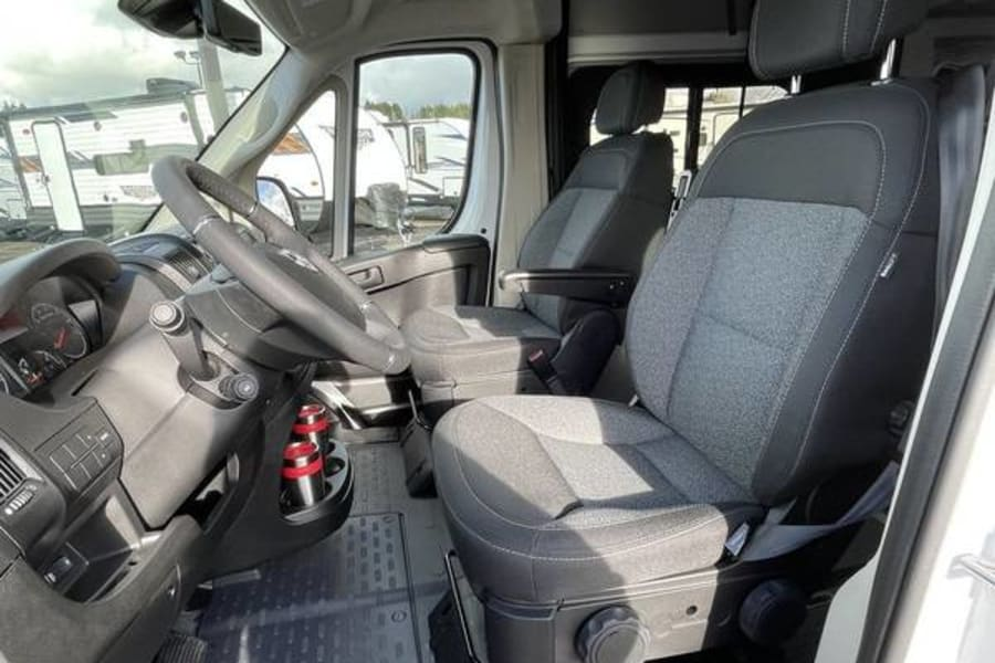View of driver and passenger seats, which are comfortable. Visibility is great and backing up no sweat with the in dash back-up camera.