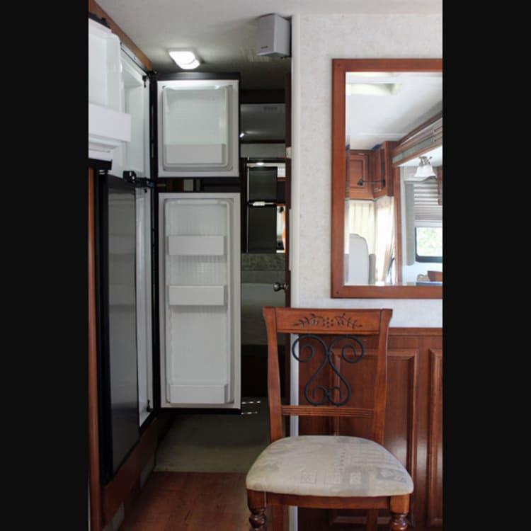 KKOACH 4-door refrigerator/freezer w/ice maker. Free standing dining room chairs!