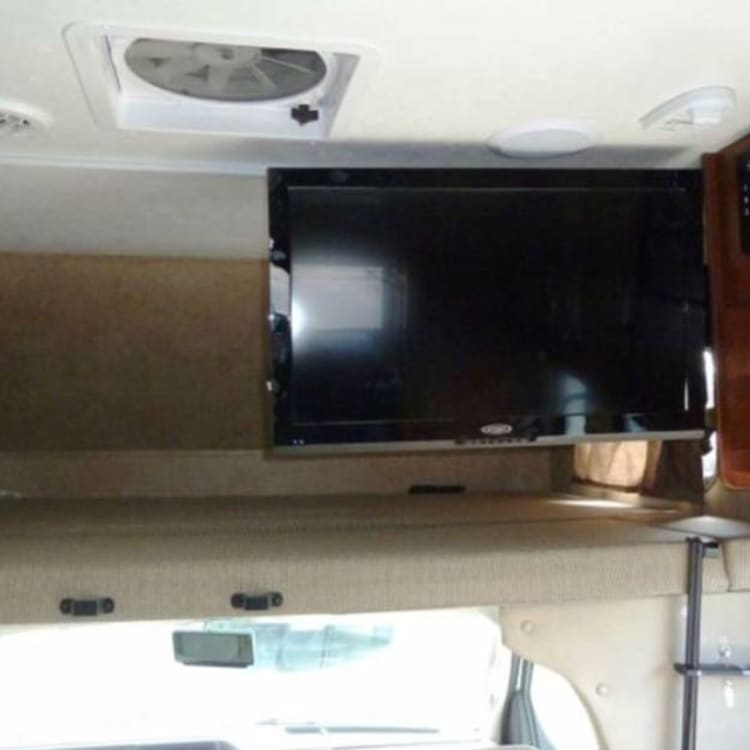 Extra Large Flat Screen with TV/DVD combo & stereo. Queen sized bed over cab with privacy curtain!