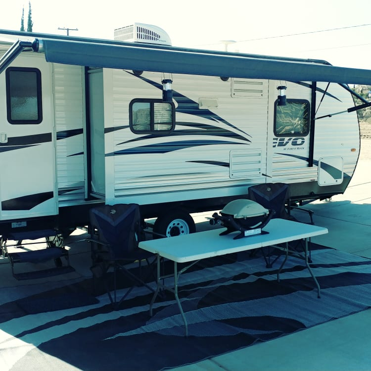 Passenger side electric awning, pop out, and stabilizer jacks