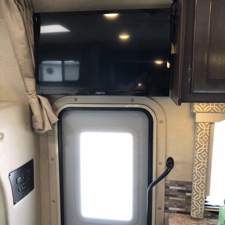 "32"" LED TV on Manual Swivel above door."