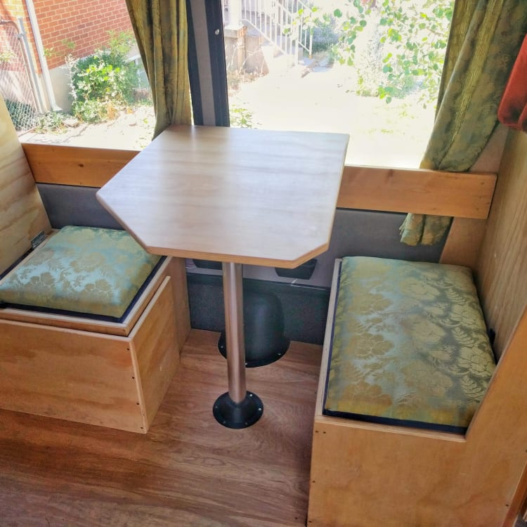 The booth is perfect for two.  The left (smaller) seat has a backrest that folds down to form the cover of the bench.