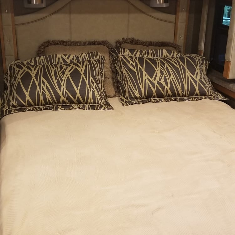 Master bedroom with a very comfy queen size bed, large double closet,  dresser drawers, tv and much more.