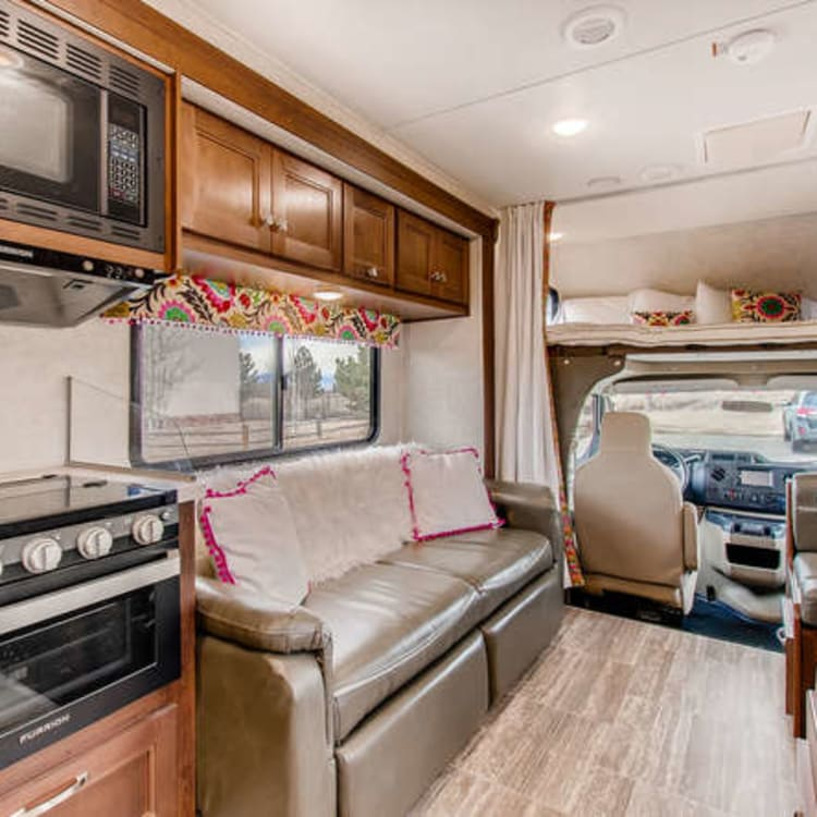 Jack knife couch folds down, Queen size bed area above the cab