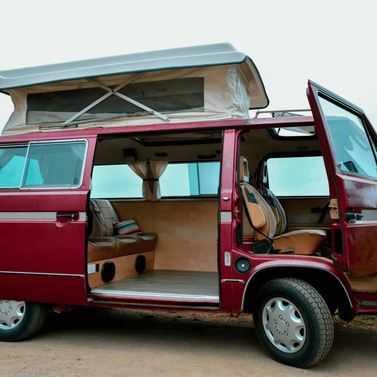 This custom VW camper van comfortably sleeps four, two up top and two down below.