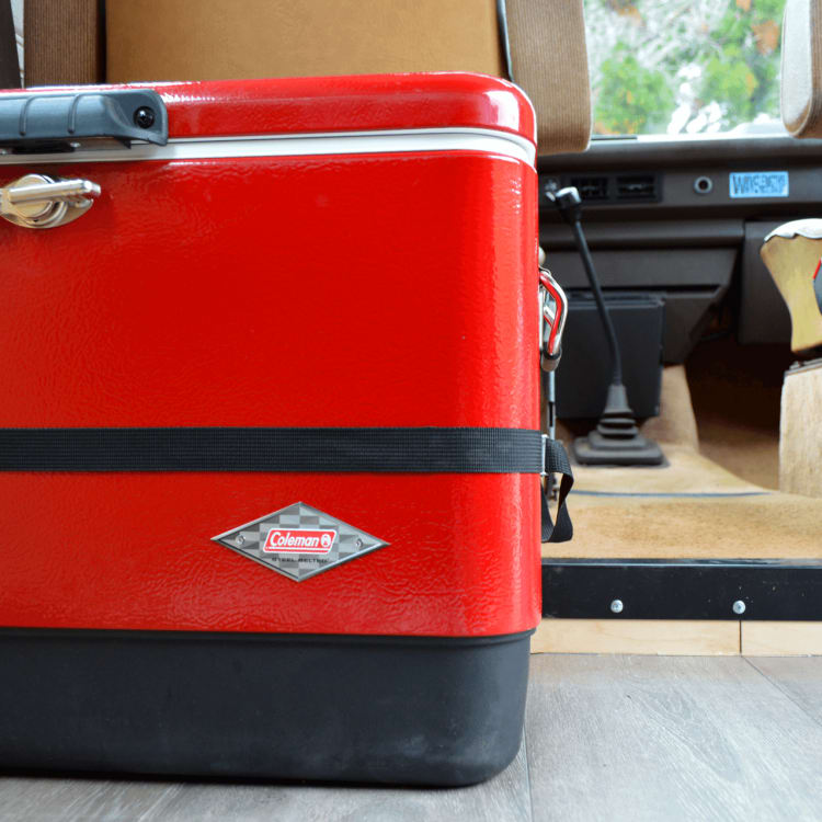 Murphy comes complete with all of your basic camping necessities, like this vintage Coleman cooler. All included accessories are secured in the cabin or stored in the van's low-profile drawers.