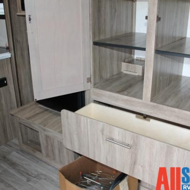 Cupboard and drawer space to store your food and clothing, also features as the slide out!